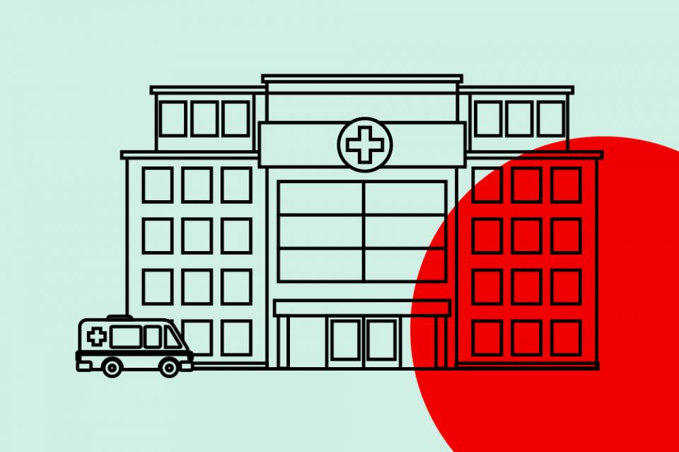 Krankenhaus mit Rettungswagen